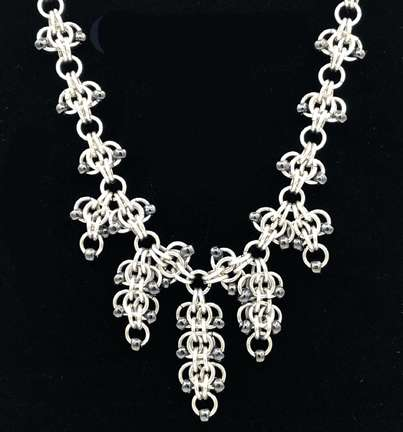 Grapevine Necklace by Corey Milliren ©2021 Aluminum Jump Rings, Glass Beads Silver Findings, Chain Mail